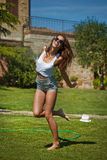 Woman having fun in summer garden Royalty Free Stock Photography
