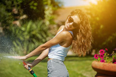 Woman having fun in summer garden Stock Photo