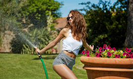 Woman having fun in summer garden Stock Image