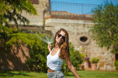 Woman having fun in summer garden Royalty Free Stock Photo