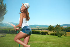 Woman having fun in summer garden Royalty Free Stock Image