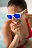 Woman having fun on summer vacation at pool jacuzzi Royalty Free Stock Photos