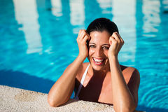 Woman having fun on summer vacation in spa hotel pool Stock Images
