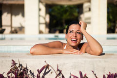 Woman having fun on summer vacation in spa hotel pool Royalty Free Stock Photos