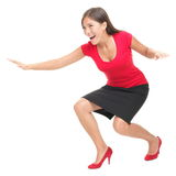 Woman having fun surfing. Woman in red having fun surfing / doing surf move. Casual funny young Asian / Caucasian businesswoman isolated on white background Stock Photos