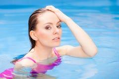 Woman having fun in swimming pool Royalty Free Stock Image