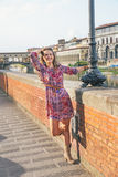 Woman having fun time walking on embankment, Italy Stock Photo