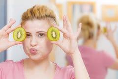 Woman having gel mask on face holding kiwi Royalty Free Stock Photography