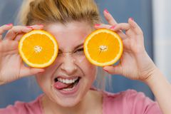 Woman having gel mask on face holding orange. Facial skin and body care, vitamins good complexion treatment at home concept. Young woman having gel mask on her Royalty Free Stock Photography