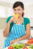 Woman having a glass of fresh juice Royalty Free Stock Images