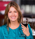 Woman having a glass of wine Royalty Free Stock Photography