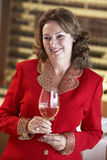 Woman Having A Glass Of Wine At A Bar Royalty Free Stock Photos