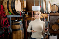 Woman having glass of wine in wine house Royalty Free Stock Images