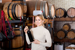 Woman having glass of wine in wine house Stock Photo