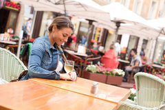 Woman having a glass of wine Royalty Free Stock Image
