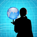 Woman having globe at finger tip Royalty Free Stock Photo
