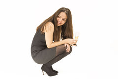 Woman having a good time drinking champagne. Royalty Free Stock Photography