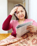 Woman having grief  after readed news Stock Photo