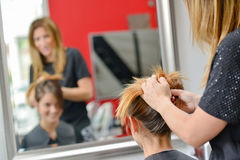 Woman having hair done. Woman having her hair done Stock Images