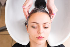 Woman Having Hair Washed by Stylist in Salon Stock Photos