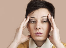 Woman having head ache Stock Image