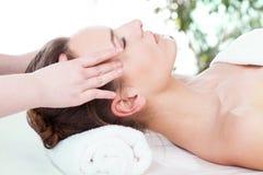 Woman having head massage Stock Photos