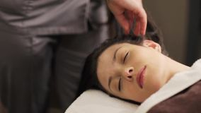 Woman having head massage at spa stock footage