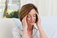 Woman having a headache Royalty Free Stock Photography