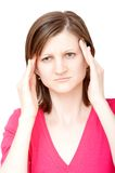 Woman having a headache. Young woman touching her temples with both hands having a headache Royalty Free Stock Images