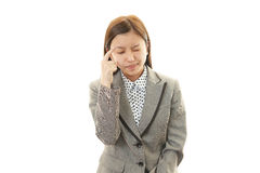Woman having a headache Stock Images