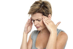 Woman having headache. Holding her head Royalty Free Stock Images