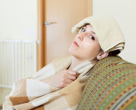 Woman having headache holding towel Royalty Free Stock Photo