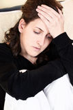 Woman having headache at home Stock Images