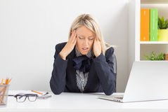 Woman having headache while sitting Royalty Free Stock Photo