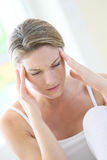 Woman having a headache after a stressful day Stock Images