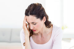 Woman having headache Stock Images