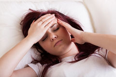 Woman having a headache Stock Image