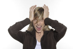 woman having a headacke and holding her head Royalty Free Stock Images