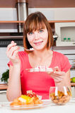 Woman having a healthy breakfast. Beautiful woman having a healthy breakfast Stock Photography