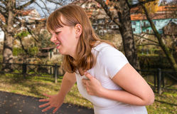 Woman having heart attack in autumn park Stock Images