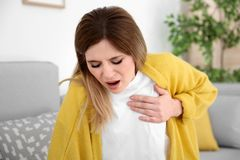 Woman having heart attack. At home royalty free stock image