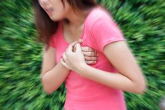 Woman having heart attack at outdoor - Angina Pectoris, Myocardial Infarction. royalty free stock images