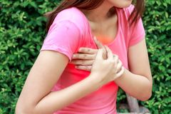Woman having heart attack at outdoor - Angina Pectoris, Myocardial Infarction. Woman having heart attack at outdoor - Angina Pectoris, Myocardial Infarction royalty free stock images