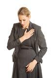 Woman having heart disease. Royalty Free Stock Photos