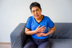 Woman having a heartache. A portrait of a woman suffering from a heartache Stock Images