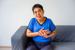 Woman having a heartache Stock Photos