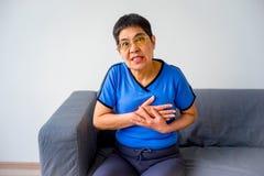 Woman having a heartache. A portrait of a woman suffering from a heartache Stock Photos