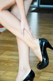 Woman having heel or ankle pain Royalty Free Stock Images