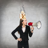 Woman having her brain on fire because of stress Royalty Free Stock Photography
