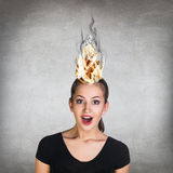 Woman having her brain on fire because of stress Royalty Free Stock Photos